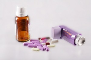 inhaler, syrup and capsules with a medicine