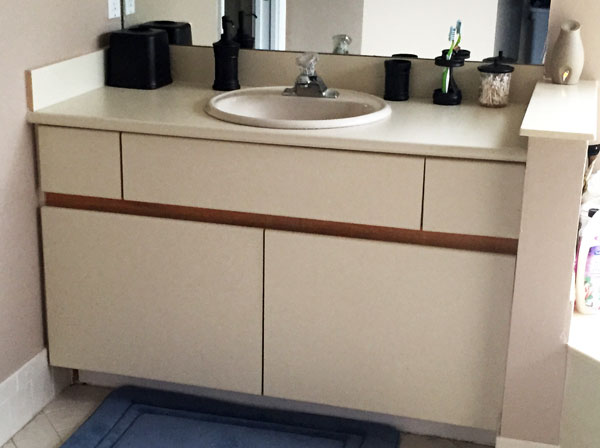 Diy inexpensive bathroom cabinet makeover for Laminate cabinets