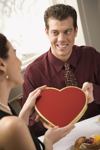 Man giving woman Valentine.