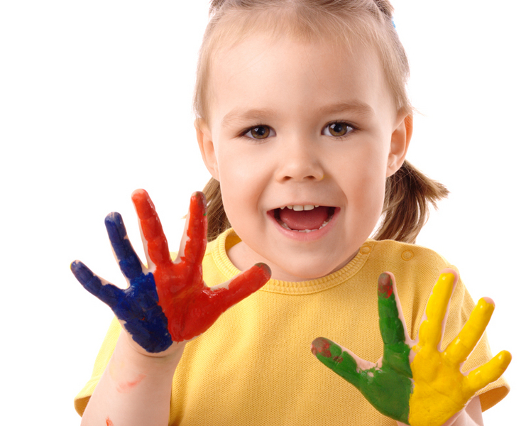 Cute cheerful child with painted hands, isolated over white
